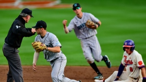 FILE - In this Wednesday, March 13, 2019, file photo, Coastal Carolina's Cory Wood, left, and Scott McKeon, center, react after tagging Clemson's Logan Davidson, right, out at second base during an NCAA college baseball game, in Clemson, S.C. Coastal Carolina already had a small athletic budget, and that was before a 15% spending cut was ordered because of projected declines in state funding and student fees stemming from the coronavirus pandemic. The school's 19-sport program includes about 450 athletes, and with individual tests currently costing about $100, testing could cost hundreds of thousands of dollars by the end of the 2020-21 academic year. (AP Photo/Richard Shiro, File)