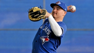 Toronto Blue Jays catcher Reese McGuire loosens up during full squad workouts at the team's spring training complex in Dunedin, Fla., on Wednesday, February 19, 2020. THE CANADIAN PRESS/Steve Nesius