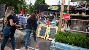 Patrons are led to their seats on the patio at Banditos, a restaurant in Ottawa, on its first day of reopening as Ontario moves into Stage 2 of its plan to lift lockdowns implemented in response to the COVID-19 pandemic, on Friday, June 12, 2020. Whistle while you work to help Ontario bounce back from the COVID-19 pandemic — but please, don't sing.That's the gist of the message coming from the provincial government, which has included explicit bans on singing — even dancing — in parts of its plan to reopen businesses temporarily shuttered by the deadly outbreak. THE CANADIAN PRESS/Justin Tang
