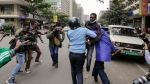 Kenyan police detain a protester at a demonstration against police brutality in downtown Nairobi, Kenya. (AP Photo/Khalil Senosi)