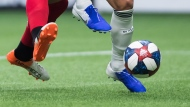 Toronto FC's Terrence Boyd, left, and Vancouver Whitecaps' Scott Sutter vie for the ball during the second half of an MLS soccer game in Vancouver on Friday May 31, 2019. THE CANADIAN PRESS/Darryl Dyck