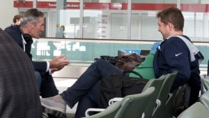 Conservative Leader Andrew Scheer, right, and Manitoba Premier Brian Pallister are shown not wearing masks at Pearson Airport in Toronto on Tuesday, July 7, 2020. THE CANADIAN PRESS/HO
