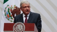 In this April 5, 2020 file photo, Mexican President Andres Manuel Lopez Obrador speaks at the National Palace in Mexico City. For his first foreign trip as president, López Obrador travels to Washington Tuesday, July 7, 2020 to meet with President Donald Trump. (AP Photo/Eduardo Verdugo, File)