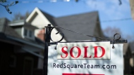 A real estate sold sign is shown in a Toronto west end neighbourhood May 17, 2020. The Canadian Real Estate Association says home sales in May regained some of the ground they lost in April, but remained down sharply compared with a year ago. THE CANADIAN PRESS/Graeme Roy