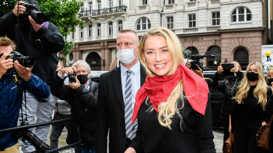 Amber Heard arrives at the High Court in London, Wednesday July 8, 2020. (AP Photo/Alberto Pezzali)