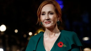 """In this Thursday, Nov. 8, 2018 file photo, writer J.K. Rowling poses for the media at the world premiere of the film """"Fantastic Beasts: The Crimes of Grindelwald"""" in Paris. Dozens of artists, writers and academics have signed an open letter decrying the weakening of public debate, it was announced Wednesday, July 8, 2020 warning that the free exchange of information and ideas is in jeopardy. J.K. Rowling, Salman Rushdie and Margaret Atwood are among dozens of writers, artists and academics to argue against ideological conformity in an open letter in Harper's Magazine. The letter comes amid a debate over so-called cancel culture - where prominent people face attack for sharing controversial opinions. (AP Photo/Christophe Ena, file)"""