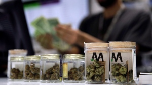In this July 1, 2017, file photo, a cashier rings up a marijuana sale at a cannabis dispensary in Las Vegas. Ontario's private cannabis stores will have to give up offering delivery and curbside pickup next week — and they're not happy about it. THE CANADIAN PRESS/AP/John Locher