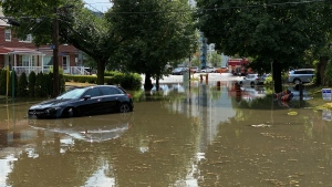 A car is seen submerged in water in Toronto on Wednesday, July 8, 2020. (Tom Podolec/ CTV News Toronto)