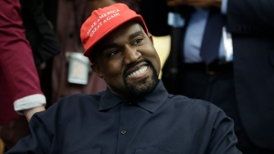 "FILE - Rapper Kanye West wears a Make America Great again hat during a meeting with President Donald Trump in the Oval Office of the White House in Washington on Oct. 11, 2018. West says he is no longer a Trump supporter. The rapper, who once praised Trump, tells Forbes in a story published Wednesday that he is ""taking the red hat off"" — a reference to Trump's trademark red ""Make America Great Again"" cap. West also insisted that his weekend announcement that he's running for President was not a stunt to drum up interest in an upcoming album. (AP Photo/Evan Vucci, File)"
