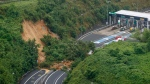 A landslide is seen near an exit of a highway in Kyoto, western Japan Thursday, July 9, 2020. Pounding rain spread to central Japan and triggered mudslides. (Kyodo News via AP)