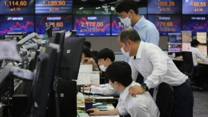 Currency traders watch monitors at the foreign exchange dealing room of the KEB Hana Bank headquarters in Seoul, South Korea, Thursday, July 9, 2020. Asian stock markets followed Wall Street higher on Thursday following gains for major U.S. tech stocks. (AP Photo/Ahn Young-joon)