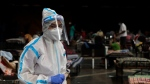 A doctor works at an COVID-19 isolation center in Mumbai, India, Wednesday, July 8, 2020. India has overtaken Russia to become the third worst-affected nation by the coronavirus pandemic. (AP Photo/Rajanish Kakade)