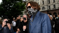 Johnny Depp arrives at the High Court in London, Thursday, July 9, 2020. (AP Photo/Alberto Pezzali)