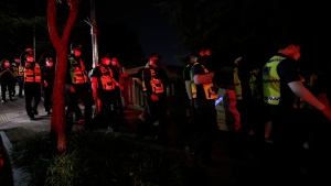 Police officers search for missing Seoul Mayor Park Won-soon in Seoul, South Korea, Thursday, July 9, 2020. (AP Photo/Lee Jin-man)
