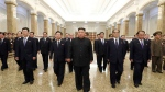 In this undated photo provided Wednesday, July 8, 2020, by the North Korean government, North Korean leader Kim Jong Un, center, visits a memorial palace where the body of his grandfather, former leader Kim Il Sung is laid, for the 26th anniversary of Kim Il Sung's death, in Pyongyang, North Korea. (Korean Central News Agency/Korea News Service via AP)