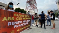 Supporters calling for the franchise renewal of ABS-CBN wait outside the ABS-CBN compound in Quezon City, Philippines Friday, July 10, 2020. Philippine lawmakers have voted to reject the license renewal of the country's largest TV network, ABS-CBN Corp. (AP Photo/Aaron Favila)