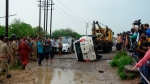The overturned vehicle that was carrying top criminal Vikas Dubey is towed away near Kanpur, India, Friday, July 10, 2020. The top suspect in dozens of crimes, including the killings of eight police officers last week, was fatally shot Friday in police custody while allegedly trying to flee, officials said. Dubey, in his 40s, had given himself up in the central town of Ujjain on Thursday after a weeklong search. A report last month by a New Delhi rights group, the National Campaign Against Torture, said at least 1,731 people died in custody during 2019, which means five custodial deaths a day. (AP Photo)