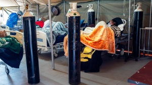 """Covid-19 patients are being treated with oxygen at the Tshwane District Hospital in Pretoria, South Africa, Friday July 10, 2020. Health Minister Zweli Mkhize this week said South Africa could run out of available hospital beds within the month. """"The storm that we have consistently warned South Africans about is now arriving,"""" he told lawmakers. The African continent overall has over 523,000 confirmed virus cases after passing the half-million milestone on Wednesday. But shortages in testing materials mean the true number is unknown.(AP Photo/Jerome Delay)"""