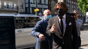 "Johnny Depp arrives at the High Court in London, Friday July 10, 2020. Depp is back in the witness box at the trial of his libel suit against a tabloid newspaper that called him a ""wife-beater"" in an April 2018 article that said he'd physically abused ex-wife Amber Heard. Depp strongly denies the allegations.(AP Photo/Alberto Pezzali)"