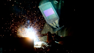 A welder fabricates a steel structure at an iron works facility in Ottawa on Monday, March 5, 2018. Statistics Canada is set this morning to give a snapshot of the job market as it was last month as pandemic-related restrictions eased and reopenings widened. THE CANADIAN PRESS/Sean Kilpatrick