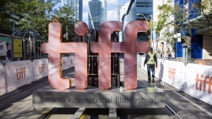 A sign bearing the Toronto International Film Festival logo is carried on a forklift down street in Toronto as preparations are made for the festival's opening night on September 7, 2017. THE CANADIAN PRESS/Chris Young