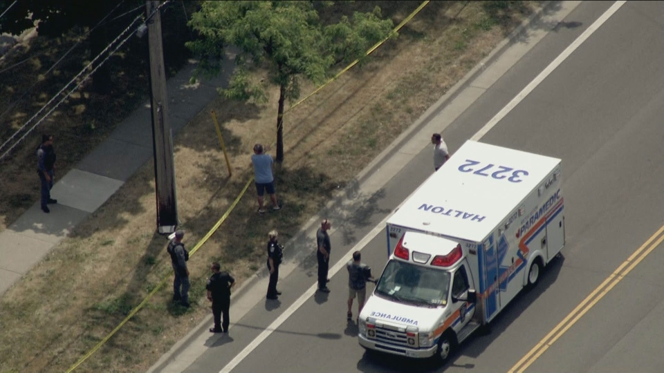An ambulance is pictured at the scene of a double shooting on Plains Road East in Burlington Friday July 10, 2020.