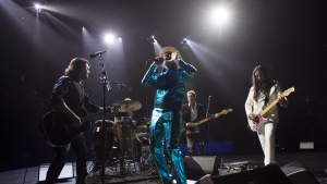 Frontman of the Tragically Hip, Gord Downie, centre, leads the band through a concert in Vancouver, Sunday, July, 24, 2016. THE CANADIAN PRESS/Jonathan Hayward