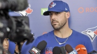 Toronto Blue Jays infielder Travis Shaw talks with reporters at the team's spring training facility in Dunedin, Fla., Sunday, Feb. 16, 2020. As the Blue Jays wait for word on whether they'll be able to play in Toronto after training camp, infielder Shaw voiced his concern Friday about the length of time players may need to stay in their closed environment at Rogers Centre and its adjoining hotel.THE CANADIAN PRESS/Steve Nesius