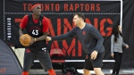 Toronto Raptors Pascal Siakam keeps the ball away from assistant coach John Corbacio during the Raptors training camp practice Tuesday, October 1, 2019 at Laval University in Quebec City. Four months to the day after COVID-19 shut down the NBA, the Toronto Raptors were finally back on the floor together. THE CANADIAN PRESS/Jacques Boissinot