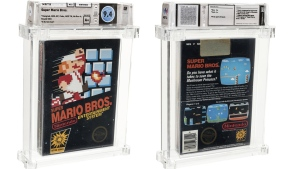 This photo provided by Heritage Auctions on Saturday, July 11, 2020, shows the front and back of an unopened copy of a vintage Super Mario Bros. video game that has been sold for $114,000 in an auction that underscored the enduring popularity of entertainment created decades earlier. (Emily Clemens/Heritage Auctions via AP)