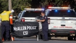 McAllen Police crime scene investigation personnel seal off the scene of a shooting where two police officers were shot and killed reportedly responding to a disturbance call, Saturday, July 11, 2020, in McAllen, Texas. (Delcia Lopez/The Monitor via AP)