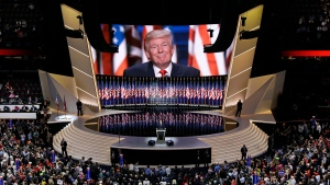 In this July 21, 2016, file photo Republican presidential candidate Donald Trump smiles as he addresses delegates during the final day session of the Republican National Convention in Cleveland. After months of insisting that the Republican National Convention go off as scheduled despite the coronavirus pandemic, Trump is slowly coming to accept that the event will not be the four-night informercial for his re-election that he had anticipated. (AP Photo/Patrick Semansky, File)