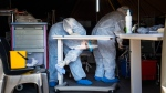 Medical staff cleans a tent where Covid-19 patients are being treated at the Tshwane District Hospital in Pretoria, South Africa, Friday July 10, 2020. (AP Photo/Jerome Delay)