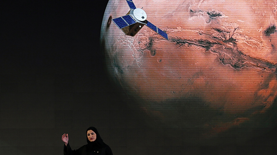 """In this Wednesday, May 6, 2015 file photo, Sarah Amiri, deputy project manager of the United Arab Emirates Mars mission, talks about the project named """"Hope,"""" or """"al-Amal"""" in Arabic, which is scheduled for launch in 2020, during a ceremony in Dubai, UAE. Three countries — the United States, China and the United Arab Emirates — are sending unmanned spacecraft to the red planet in quick succession beginning in July 2020. (AP Photo/Kamran Jebreili, File)"""