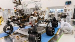 In this Dec. 17, 2019 photo made available by NASA, engineers monitor a driving test for the Mars rover Perseverance in a clean room at the Jet Propulsion Laboratory in Pasadena, Calif. The robotic vehicle, scheduled to launch on July 30, 2020, is planned to touch down in an ancient river delta and lake known as Jezero Crater, not quite as big as Florida's Lake Okeechobee. (J. Krohn/NASA via AP, File)