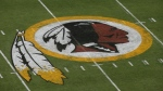 "In this Aug. 7, 2014, file photo, the Washington Redskins logo is seen on the field before the team's NFL football preseason game against the New England Patriots in Landover, Md. Washington's NFL team will get rid of the name ""Redskins"" on Monday, July 13, according to multiple reports. It's unclear when a new name will be revealed for one of the league's oldest franchises. The team launched a ""thorough review"" of the name July 3. (AP Photo/Alex Brandon, File)"