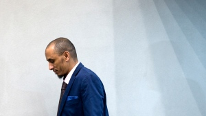 In this Wednesday April 4, 2018, file image, alleged jihadist leader Al Hassan Ag Abdoul Aziz Ag Mohamed Ag Mahmoud takes his seat in the court room for his initial appearance on charges of war crimes and crimes against humanity at the International Criminal Court in The Hague, Netherlands. The trial opened Tuesday, July 14, 2020 of an alleged Islamic extremist charged with policing a brutal Islamic regime in the Malian city of Timbukti after al-Qaida linked rebels overran the historic desert city in 2012. Al Hassan Ag Abdoul Aziz Ag Mohamed Ag Mahmoud, who sat in court wearing a face mask and white headscarf, is charged with involvement in crimes including rape, torture, enforced marriages and sexual slavery from April 2012 until the end of January 2013. (AP Photo/Peter Dejong, Pool, File)