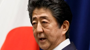 FILE - In this June 18, 2020, file photo, Japan's Prime Minister Shinzo Abe speaks during a press conference at the prime minister's official residence in Tokyo. The Abe government's Defense White Paper 2020 highlights what are potential Chinese and North Korean threats as Japan tries to further increase its defense capability. (Rodrigo Reyes Marin/Pool Photo via AP, File)