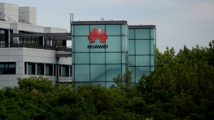 A Huawei sign is displayed on their premises in Reading, England, Tuesday, July 14, 2020. (AP Photo/Matt Dunham)