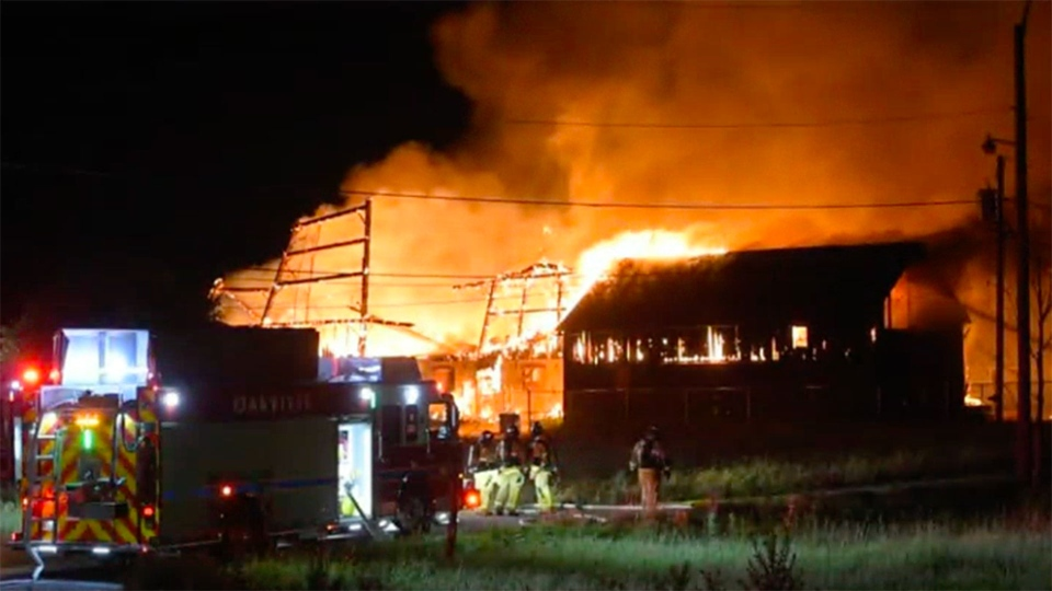 Firefighters battle a large fire at an abandoned barn near Sixth Line and Highway 407 in Oakville Tuesday July 14, 2020. (Andrew Collins)