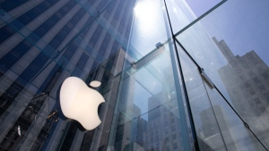 FILE - In this Tuesday, June 16, 2020 file photo, the sun is reflected on Apple's Fifth Avenue store in New York. A European Union high court on Wednesday, July 15, 2020 ruled in favor of technology giant Apple and Ireland in its dispute with the EU over 13 billion euros, 15 billion US dollars in back taxes. (AP Photo/Mark Lennihan, File)