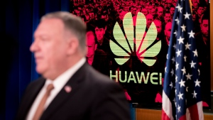"A monitor displays the logo for ""Huawei"" behind Secretary of State Mike Pompeo as he speaks during a news conference at the State Department in Washington, Wednesday, July 15, 2020. (AP Photo/Andrew Harnik, Pool)"