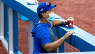 Toronto Blue Jays manager Charlie Montoyo looks on from the dugout during MLB intrasquad baseball action in Toronto on Thursday, July 9, 2020. Montoyo says he is not going to rush pitcher Chase Anderson back to action. THE CANADIAN PRESS/Carlos Osorio
