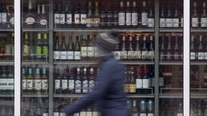 The government of Ontario is amending its liquor laws to give consumers more delivery options and to allow boat operators with liquor sales licences to temporarily sell and serve alcohol while their boats are docked. A person walks past shelves of bottles of alcohol on display at an LCBO in Ottawa, Thursday March 19, 2020. THE CANADIAN PRESS/Adrian Wyld