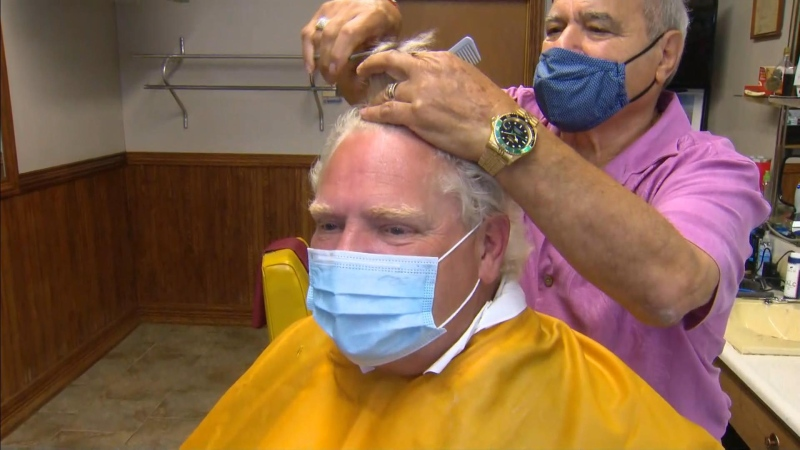 Premier Doug Ford is shown getting a hair cut at Mastronardi Barbering in Leamington on Thursday morning.