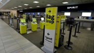 Empty Spirit Airline ticket counters are shown at the Tampa International Airport Friday, April 24, 2020, in Tampa, Fla. (AP Photo/Chris O'Meara)