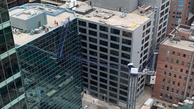 Fire crews inspect a crane that collapsed onto an office tower in downtown Toronto Thursday July 16, 2020. (Juan Santana /Submitted)
