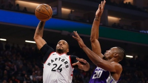 Toronto Raptors guard Norman Powell, left, goes to the basket against Sacramento Kings forward Harry Giles III, right, during the first quarter of an NBA basketball game in Sacramento, Calif., Sunday, March 8, 2020. THE CANADIAN PRESS/AP, Rich Pedroncelli
