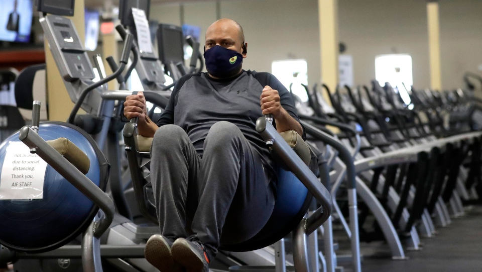 Earl Edwards, of Canton, Mass., works out on Monday, July 6, 2020, at Answer is Fitness gym, in Canton. Gym owners warn that it won't be fitness as usual as many Ontario facilities implement new measures to keep members safe while they get back in shape after months of COVID-19 languor. THE CANADIAN PRESS/AP, Steven Senne