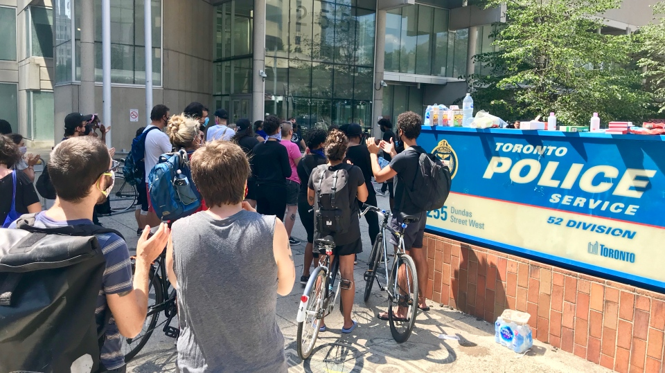 Protesters gathered outside 52 Division after three people were arrested during a Black Lives Matter protest held downtown this morning. (Francis Gibbs/ CTV News Toronto)